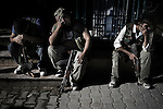 SYRIA, ALEPPO. Free Syrian Army fighters cry over the serious wounding of one of their comrades on September 27, 2012. ALESSIO ROMENZI