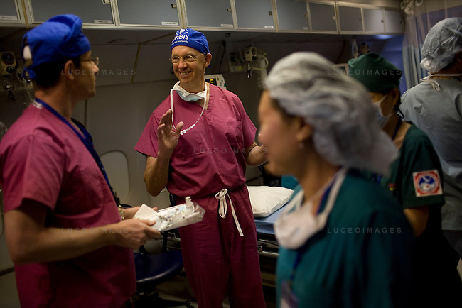 Dr. Steve Charles, of Memphis, jokes around with anesthesiologist Dr. Andrew Choyce, of London, following a successful surgery aboard the ORBIS Flying Eye Hospital on Wednesday, April 16, 2008...ORBIS Flying Eye Hospital brought doctors, nurses and specialists from all over the world to Ho Chi Minh City, Vietnam from April 7-18, 2008.  The ORBIS program contributed to the efforts of Ho Chi Minh City Eye Hospital in fighting avoidable blindness by educating local ophthalmologists to diagnose and manage pediatric blindness, retinal disease, oculoplastics, and blindness due to glaucoma.