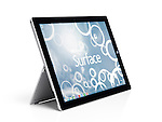 Microsoft Surface Pro 3 tablet computer with Windows 8 desktop on display isolated on white background