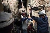 Local villagers work at a drainage construction site in Medawar Kalan in Ballia district of Uttar Pradesh, India. Photo: Sanjit Das/Panos