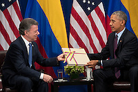 (L to R) President of Colombia Juan Manuel Santos gives United States President Barack Obama a copy of the Colombian peace agreement during bilateral meeting at the Lotte New York Palace Hotel, September 21, 2016 in New York City. In Tuesday's speech to the United Nations General Assembly, Obama stated that 'helping Colombia end Latin America's longest war' was among his major accomplishments as president. Last month, the Colombian government reached a peace agreement with the Revolutionary Armed Forces of Colombia (FARC). <br /> Credit: Drew Angerer / Pool via CNP /MediaPunch