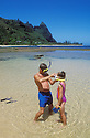 Father & daughter with snorkel gear at Tunnels Beach; Haena, Kauai, Hawaii.  .#1258-3116   [MR]