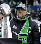 Seahawks owner and Chairman of Vulcan Sports and Entertainment,  Paul Allen looks out over the crowd during the Super Bowl XLVIII celebration at  CenturyLink Field on February 5, 2014 in Seattle. Allen, who bought a struggling Seattle Seahawks franchise in 1997, now, after 17 years, his team beat the Denver Broncos  43-8 to become Super Bowl Champions. ©2014. Jim Bryant Photo. ALL RIGHTS RESERVED.