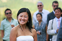 Phuong walks down the aisle during her wedding ceremony in the Methow Valley as guests look on.(Photo by Dan DeLong/Red Box Pictures)