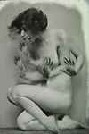 A naked young lady with many hands