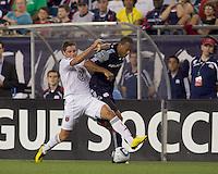 New England Revolution forward Khano Smith (18) fails to dribble beyond DC United midfielder Devon McTavish (18). The New England Revolution defeated DC United, 1-0, at Gillette Stadium on August 7, 2010.
