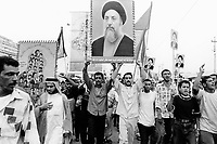Iraq. Basrah. The crowd celebrates the return of exile after 23 years in Iran of the shia ayatollah Mohammed Baqer el-Hakim, leader of the Supreme Council for Islamic Revolution in Iraq. He just crossed by car the border a few hours ago. He wears a black turban on his head and has a beard. Mohammed Baqer el-Hakim has been killed in a car bomb attack in Najaf on august 29 2003. Assasination attempt. © 2003 Didier Ruef