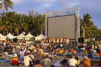 """Sunset on the Beach"" attracts visitors and locals alike to Waikiki Beach to enjoy hula dancing, local food, a movie and of course a beautiful Hawaiian sunset on Oahu."