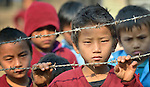 Children wait for school to begin in the village of Tanglichowk in the Gorkha District of Nepal. In the aftermath of the April 2015 earthquake that ravaged Nepal, the ACT Alliance helped people in this village with a variety of services, including latrines, emergency shelter, livelihood projects and school construction.
