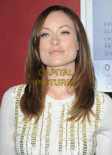 Olivia Wilde.at The Magnolia Pictures L.A. Premiere of 'Deadfall' held at The Arclight Theatre in Hollywood, California, USA,  November 29th 2012..portrait headshot gold white cream cardigan knit knitted                .CAP/DVS.©Debbie VanStory/Capital Pictures.