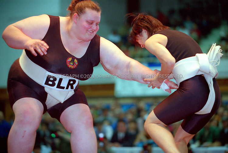 10/26/2001--Hirosaki, Aomori Prefecture, Japan..Hoi Chi Chan (Hong Kong--right) vs. Veranika Kazlovkaya Belarus at the World international sumo tournament....All photographs ©2003 Stuart Isett.All rights reserved.This image may not be reproduced without expressed written permission from Stuart Isett.