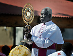 Monsignor Anania Ladu of the Archdiocese of Juba holds aloft the Blessed Sacrament as Catholics in Southern Sudan participate in a procession through the streets of Juba on November 20 to pray for a peaceful January 2011 referendum on secession from the north of the country. The independence vote has widespread support throughout Southern Sudan, including among Catholics and other Christians. The Blessed Sacrament was carried on the back of a truck throughout the entire procession.