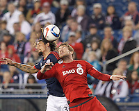 Foxborough, Massachusetts - May 16, 2015: First half action. In a Major League Soccer (MLS) match, the New England Revolution (blue/white) vs Toronto FC (red), 1-0 (halftime), at Gillette Stadium.