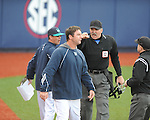 North Carolina-Wilmington pitching coach Jason Howell (center), who was ejected, and head coach Mark Scalf (left) argue with home plate umpire Steve Dew at Oxford-University Stadium in Oxford, Miss. on Saturday, February 25, 2012. Ole Miss won 6-4.