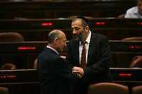 Shas party leader Aryeh Deri and Israel's Minister of Tourism Uzi Landau seen during a plenum session in the assembly hall of the Israeli parliament on July 31, 2013. Photo by Oren Nahshon