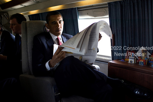 Washington, DC - May 21, 2009 -- United States President Barack Obama reads a morning newspaper aboard Marine One while en route to the U.S. Naval Academy commencement, May 22, 2009. .Mandatory Credit: Pete Souza - White House via CNP