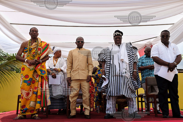 Dignitaries on the dais at a swearing-in ceremony for newly elected members of a council of Queen Mothers. A Queen Mother is a traditional female leader, drawn from the relevant chiefly lineage, who is responsible for women's and children's issues in particular. Though often widely respected and sometimes powerful, especially in matrilineal ethnic groups, their authority is subject to a male chief. After being suppressed during the colonial era, the role of Queen Mother is being revived in Ghana and is seen by many as a force for development.