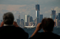 The space shuttle Enterprise is towed by barge past lower Manhattan June 3, 2012 in New York on its way to dock in Port Elizabeth, New Jersey. Enterprise is scheduled to be moved by barge June 5 to the Intrepid Sea.  Photo by Kena Betancur / VIEWpress..