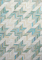 Houndstooth, a handmade mosaic shown in Aquamarine and Quartz jewel glass, is part of the Houndstooth Collection by Sara Baldwin for New Ravenna.<br />