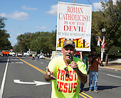 A man demonstrates with anti-Catholic slogans near The White House in Washington, DC where United States President Barack Obama hosted an Official State Welcome ceremony for Pope Francis on Wednesday, September 23, 2015.  <br /> Credit: Chris Kleponis / CNP