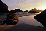 Cape Sebastian State Park Southern Oregon Coast Highway 101 sunset low tide with tidal pools on beach with rock formations Oregon State USA