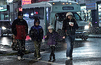Snow falls on while people cross a street in Union City as Winter storm Dion Begins to affect New York area. The New York City Department of Sanitation issued a snow alert on December 08, 2013, Photo by Kena Betancur / VIEWpress.
