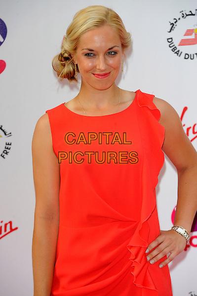 Sabine Lisicki<br /> The WTA Pre Wimbledon Party, Kensington Roof Gardens, London, England, UK,<br /> 20th June 2013.<br /> half  length sleeveless red dress hand on hip <br /> CAP/CJ<br /> &copy;Chris Joseph/Capital Pictures