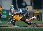 16 April 2016: University of Maryland, Baltimore County Retriever Midfielder and Face Off specialist Steven Larson, a Junior from Scottsdale, AZ, battles University of Vermont Catamount Face Off specialist Luc LeBlanc, a Junior from Essex, VT, during a game at Virtue Field in Burlington, Vermont. The Retrievers fell to the Catamounts 14-10 in NCAA Division I play. Mandatory Credit: Ed Wolfstein Photo *** RAW (NEF) Image File Available ***