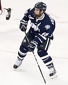 Brett Kostolansky (UNH - 15) - The Boston College Eagles defeated the visiting University of New Hampshire Wildcats 5-2 on Friday, January 11, 2013, at Kelley Rink in Conte Forum in Chestnut Hill, Massachusetts.