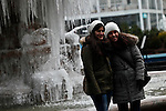 Tourists poses for a picture next to a frozen water source in New York, United States. 23/01/2013 Photo by Kena Betancur/VIEWpress.