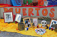 "Mesa, Arizona. October 28, 2012 - The Day of the Dead is a religious holiday celebrated in Mexico with a solemn mood to remember dead loved ones. However, in the Southwest of the United States and in states like Arizona, the holiday takes a form of a cultural festivity, the turning the traditional ""Día de los Muertos"" into a festival-like event. The Day of the Dead seeks to make remembrance of those loved one who have died on November 2. Typically, people make small altars that include the photo of the deceased as well as candles and other objects. Photo Eduardo Barraza © 2012"