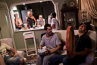 Young people drinking, smoking and socialising in a private house.