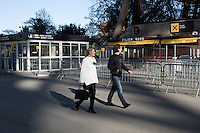 PARIS, FRANCE - NOVEMBER 15: Tourists walking under the Eiffel tower 2 days after the terrorist attacks in Paris, November 15, 2015 at rue Albert. All the museums as well as cultural places such as th Eiffel towers are closed due to state of emergency after the attacks in Paris.