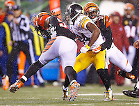 Antonio Brown #84 of the Pittsburgh Steelers is hit by Vontaze Burfict #55 of the Cincinnati Bengals in the fourth quarter during the Wild Card playoff game at Paul Brown Stadium on January 9, 2016 in Cincinnati, Ohio. Brown would leave the game with a concussion. (Photo by Jared Wickerham/DKPittsburghSports)