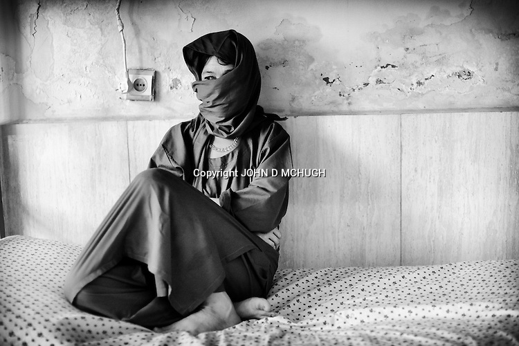 A recovering drug addict is seen in a drug treatment clinic in Mazar-e Sharif, 26 September 2013. There has been a huge explosion in the number of drug users in Afghanistan, with recent figures suggesting that of the 35 million populations, 1 million are addicts. (John D McHugh)