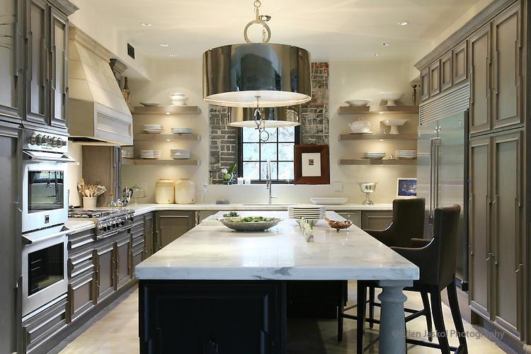 cabinets and Calcutta Gold Carrera marble countertops in the kitchen