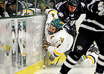 6 December 2009: University of Vermont Catamount defenseman Patrick Cullity, a Senior from Tewsbury, MA, is checked into the boards during a game against the University of New Hampshire Wildcats at Gutterson Fieldhouse in Burlington, Vermont. The Wildcats defeated the Catamounts 5-2 in the Hockey East matchup. Mandatory Credit: Ed Wolfstein Photo