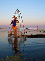 Traditional Fisherman on Inle Lake at sunrise, Shan State Myanmar/Burma