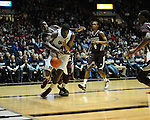 Ole Miss' Demarco Cox (4) vs. Mississippi State's Renardo Sidney (1) at the C.M. &quot;Tad&quot; Smith Coliseum in Oxford, Miss. on Wednesday, January 18, 2012. Mississippi won 75-68.