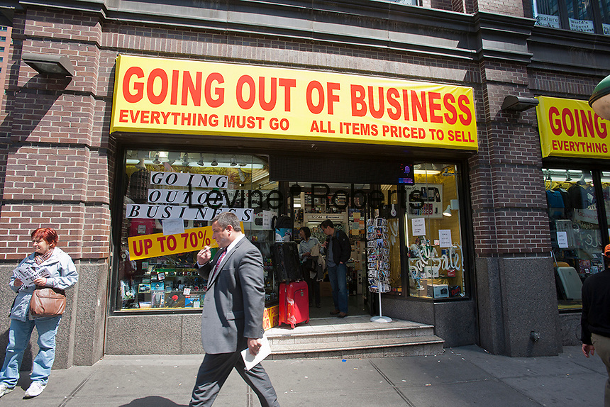 An electronics store on Broadway in Times Square in New York on Friday, April 20, 2012 dramatically announces that it is soon going out of business. (© Richard B. Levine)