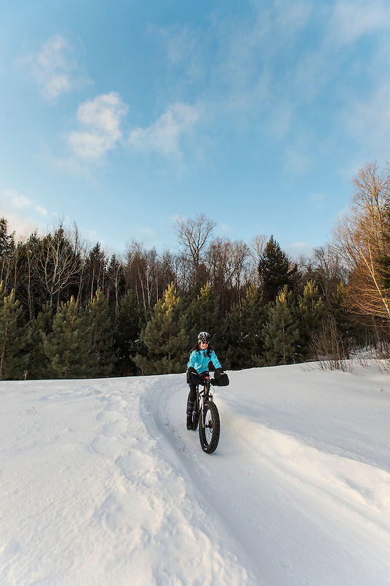 Winter cycling fat biking snow biking on the Snow Bike Route in Marquette, Michigan.