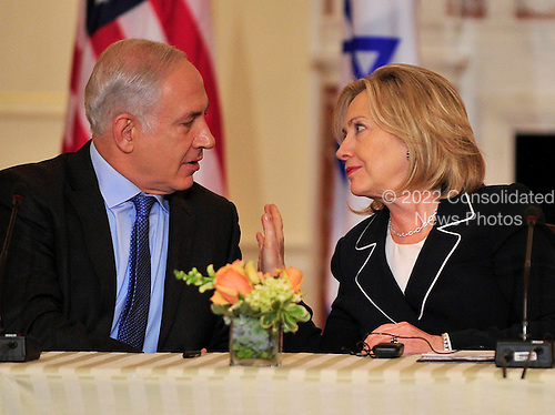 "United States Secretary of State Hillary Rodham Clinton shares some thoughts with Prime Minister Benjamin Netanyahu of Israel as she hosts the ""Relaunch of Direct Negotiations Between the Israelis and Palestinians"" in the Benjamin Franklin Room of the U.S. Department of State on Thursday, September 2, 2010.  .Credit: Ron Sachs / CNP.(RESTRICTION: NO New York or New Jersey Newspapers or newspapers within a 75 mile radius of New York City)"