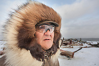 Native Alaskan Inupiat man portrait with wolverine fur ruff parka, Kaktovik, Alaska.