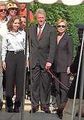 The First Family poses for a family portrait as they depart the White House for their two week vacation in Martha's Vineyard, Massachusetts on Thursday, August 19, 1999.  The President celebrated his 53rd birthday earlier in the day at a party thrown for him by approximately 200 members of the White House staff and volunteers on the South Lawn. (L-R) Chelsea Clinton, U.S. President Bill Clinton, First Lady Hillary Rodham Clinton.  On Tuesday, August 17, 1999, the President testified before the Grand Jury on his involvement in the Monica Lewinsky scandal and subsequently made a nationally televised statement admitting he had an inappropriate relationship with Ms. Lewinsky.<br /> Credit: Ron Sachs / CNP