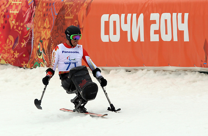 14/03/2014. Canadian Josh Dueck competes in the men's super combined sit ski event at the 2014 Sochi Paralympic Winter Games in Sochi. Dueck went on to win the gold medal. (Photo: Scott Grant/Canadian Paralympic Committee)