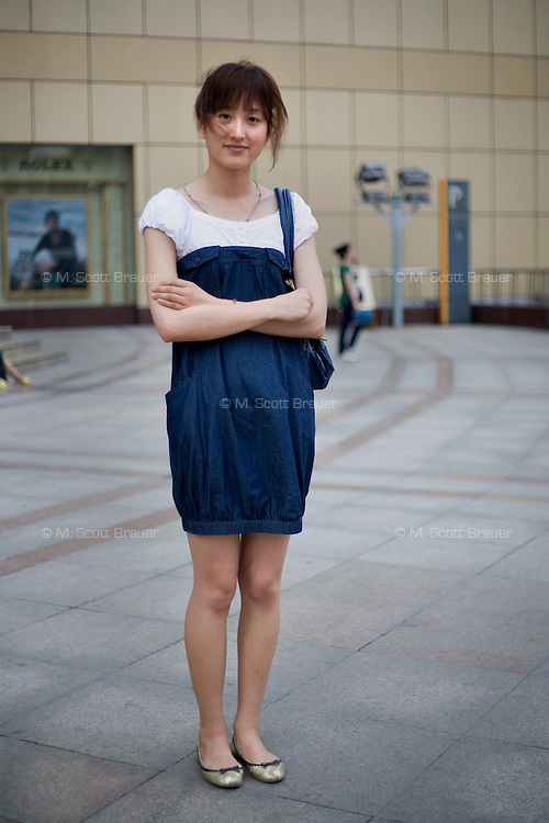 Meilongyu, a weather forecaster, age 24, poses for a portrait in Nanjing. Response to 'What does China mean to you?': 'Mother country.'  Response to 'What is your role in China's future?': 'To have an important role in the development of world peace and economic development.'