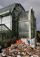 Tropical Rainforest Glasshouse (formerly Le Jardin d'Hiver or Winter Gardens), 1936, René Berger, Jardin des Plantes, Museum National d'Histoire Naturelle, Paris, France. Low angle view from the side of the main Art Deco style facade, with rubble from the renovation works.