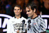 January 29, 2017: Rafael Nadal of Spain looks on as Roger Federer of Switzerland poses for photographs after winning the Men's Final on day 14 of the 2017 Australian Open Grand Slam tennis tournament in Melbourne, Australia. Photo Sydney Low