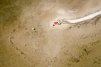 A family plays on the sands of the Bay of Puck (Zatoka Pucka) next to its shallow waters.