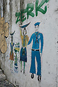 Lisbon, Portugal. 15.04.2016. Street art depicting a male sailor and two women carrying goods on their heads, Alfama, Lisbon. Photograph © Jane Hobson.